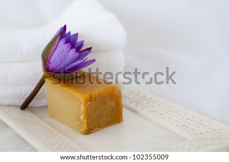 lotus flower, natural soap and marble tray - stock photo