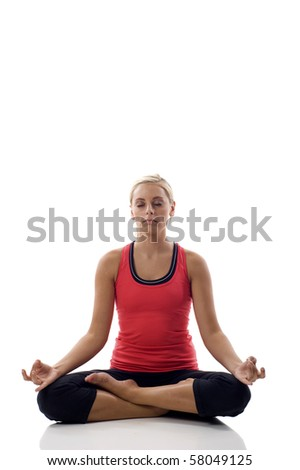Lotus position - Portrait of a cute young female practicing yoga - stock photo