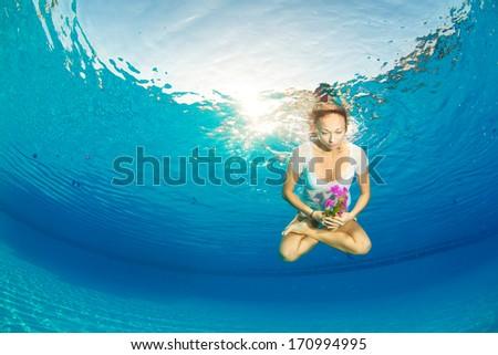 lotus posture underwater - stock photo