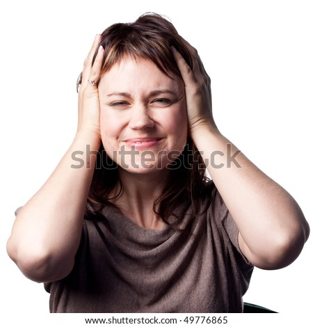 Loud noise forces this woman to cover her ears - stock photo