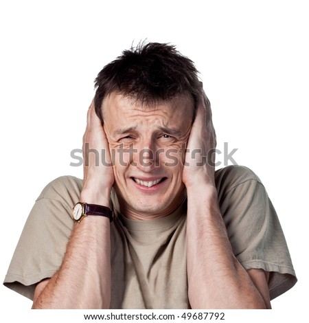 Loud noise hurting his ears - stock photo