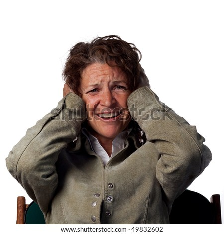 Loud noise makes this woman cover her ears - stock photo