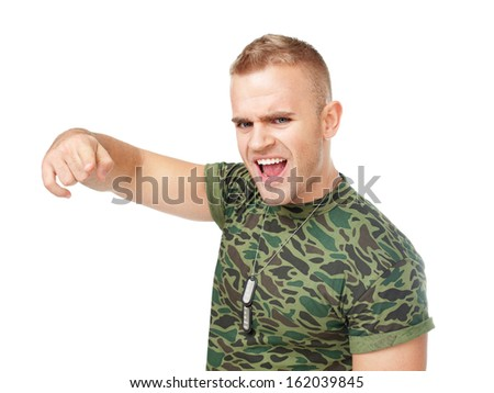 Loud scream of anger furious army soldier pointing towards camera isolated on white background - stock photo