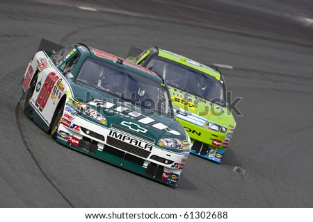 LOUDON, NH - SEP 18:  Dale Earnhardt, Jr. brings his Amp Chevrolet through the turns during practice for the Sylvania 300 race at the New Hampshire Motor Speedway in Loudon, NH on Sept 18, 2010 - stock photo