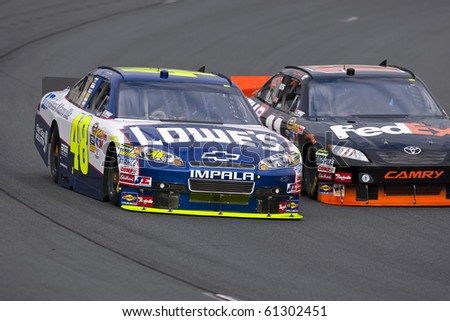 LOUDON, NH - SEP 18:  Jimmie Johnson brings his Lowe's Chevrolet through the turns during practice for the Sylvania 300 race at the New Hampshire Motor Speedway in Loudon, NH on Sept 18, 2010 - stock photo
