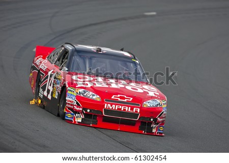LOUDON, NH - SEP 18:  Tony Stewart brings his Office Depot car through the turns during practice for the Sylvania 300 race at the New Hampshire Motor Speedway in Loudon, NH on Sept 18, 2010 - stock photo