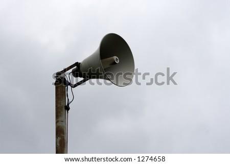 Loudspeaker against sky - stock photo