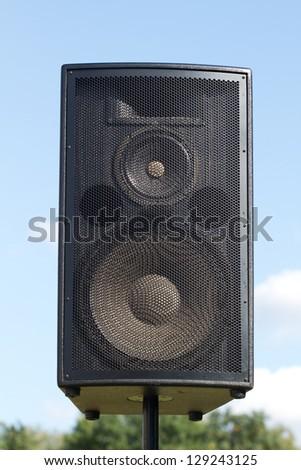 loudspeaker on the blue sky - stock photo
