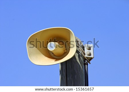 Loudspeaker on the wooden pole