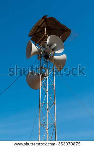 Loudspeakers broadcast ,Blue sky background