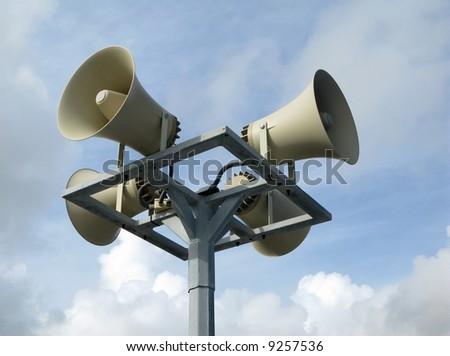 Loudspeakers detail against blue sky communication concept - stock photo