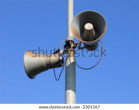 Loudspeakers under blue sky - stock photo