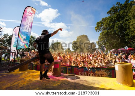 LOUGH CUTRA, GORT, IRELAND - SEPTEMBER 6: Unidentified people having fun and get showered in powdered dye during  annual RUN OR DYE, the 5K event, on September 6, 2014 in Lough Cutra, Gort, Ireland. - stock photo