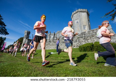 LOUGH CUTRA, GORT, IRELAND - SEPTEMBER 6: Unidentified people having fun and runing through the course during annual RUN OR DYE, the 5K event, on September 6, 2014 in Lough Cutra, Gort, Ireland. - stock photo