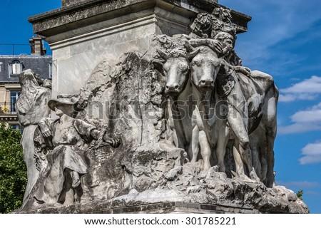 Louis Pasteur monument. In 1904 sculptor Alexander Falguire built the monumental statue of Pasteur, which still exists today. Paris, Place de Breteuil, France. - stock photo