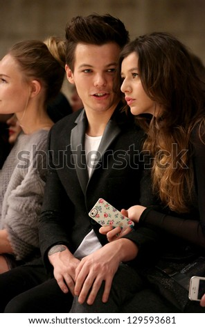 Louis Tomlinson and girlfriend Eleanor Calder at the Unique show as part of London Fashion Week AW13, Tate Modern, London. 17/02/2013 Picture by: Henry Harris