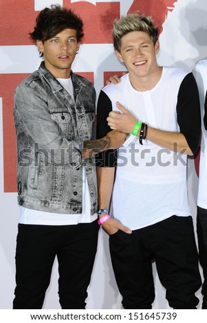 Louis Tomlinson and Niall Horan from One Direction at the One Direction This is Us film - press conference, London. 19/08/2013 - stock photo