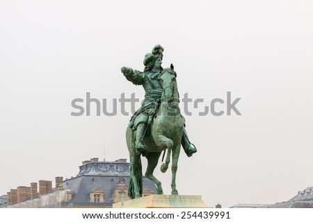 Louis XIV on horse bronze statue in Versailles - stock photo