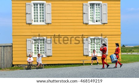 LOUISBOURG, CANADA - JULY 30, 2016:  Actors in period costume perform for tourists the Fortress of Louisbourg, which reenacts life at the French colony in the 1700s.