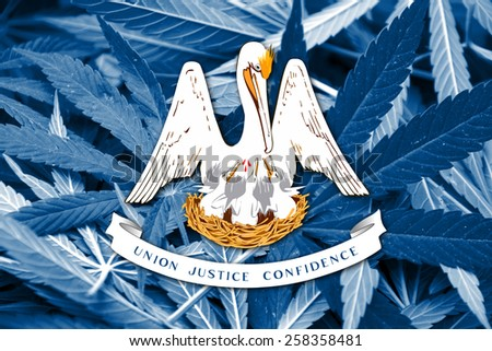 Louisiana State Flag on cannabis background. Drug policy. Legalization of marijuana - stock photo