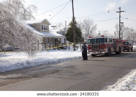 LOUISVILLE - 31 JANUARY: Engine 18 firemen discuss a downed residential power line while waiting for electric crews to respond in Louisville, KY after the January 2009 ice storm. - stock photo