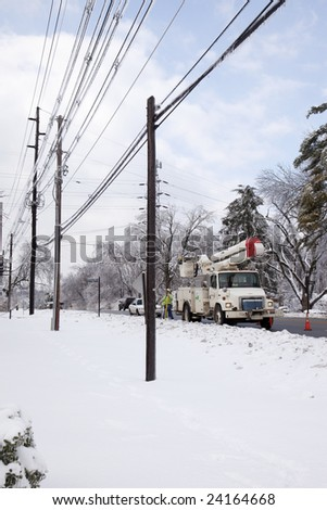 LOUISVILLE - 30 JANUARY: Georgia Power crew working to restore electric service along Brownsboro Road in Louisville, Kentucky after the January 2009 ice and snow storm that left millions without power - stock photo