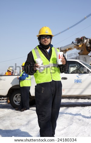LOUISVILLE - 31 JANUARY: Pike Electric worker, Levi Galeana, taking a break while working in brutal cold to restore power to Louisville, KY, after the January 2009 ice storm. - stock photo