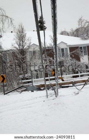 LOUISVILLE, KENTUCKY, 28 JANUARY: Electric utility lines brought down to the ground knocking out power in the Douglass Hills neighborhood in Louisville, Kentucky, during a powerful storm on January 28, 2009. - stock photo