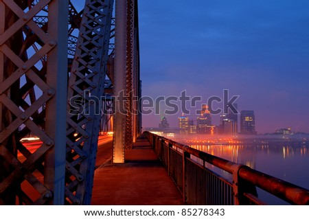 Louisville, Kentucky Skyline overlooking the Ohio River at sunrise during rush hour traffic. - stock photo