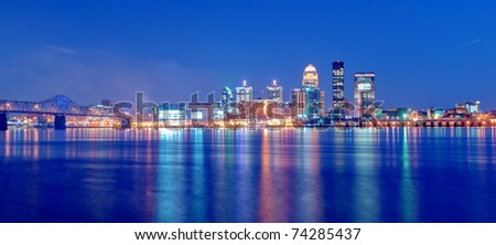 Louisville, Kentucky Skyline overlooking the Ohio River at Sunset - stock photo