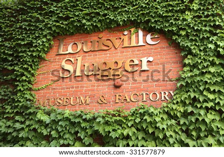 LOUISVILLE, KENTUCKY, USA - June 14, 2015:  The Louisville Slugger Museum and Factory sign, home of the world famous Louisville Slugger baseball bat.  - stock photo