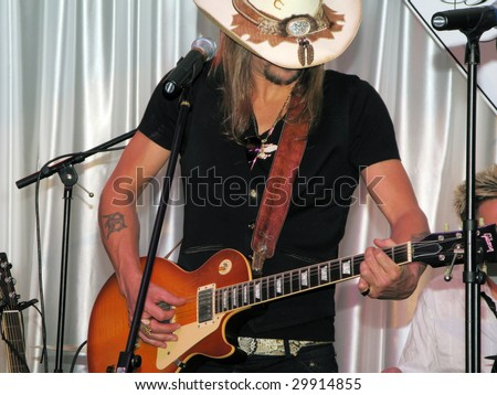 LOUISVILLE, KY - MAY 1: Kid Rock performs at the 2009 Barnstable-Brown Gala on May 1, 2009.  The annual gala is held on the eve of the Kentucky Derby to benefit diabetes research. - stock photo
