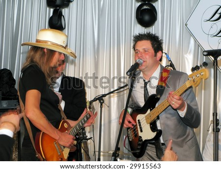 LOUISVILLE, KY - MAY 1: Kid Rock performs with Rascal Flatts' Jay DeMarcus at the 2009 Barnstable-Brown Gala on May 1, 2009.  The annual Kentucky Derby eve event benefits diabetes research. - stock photo