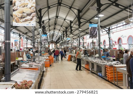 LOULE, PORTUGAL - APRIL 4: Interior of the traditional portuguese market in Loule. April 4th 2015 in Loule, Algarve, Portugal, this market is the biggest market hall of the algarve - stock photo
