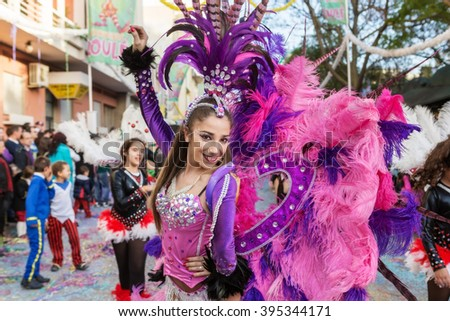 LOULE, PORTUGAL - February 2016: Cheerful carnival (Carnaval) parade in the city of Loule, Algarve, Portugal. Participants cheer people. Editorial. - stock photo