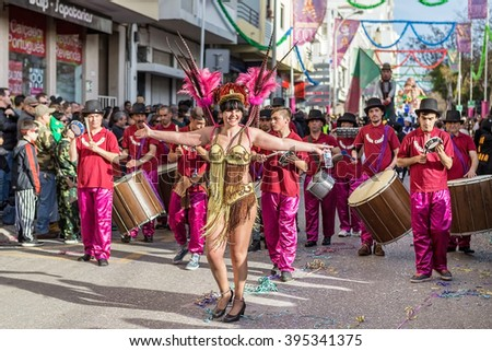 LOULE, PORTUGAL - February 2016: Cheerful carnival parade in the city of Loule, Algarve, Portugal. Participants cheer people. Editorial. - stock photo