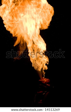 LOULE, PORTUGAL - JUNE 26:fire eater  performs onstage at Festival Med June 26, 2008 in Loule, Portugal. - stock photo