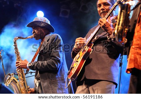 LOULE, PORTUGAL - JUNE 25: Orchestra Baobab performs onstage at Festival Med June 25, 2010 in Loule, Portugal. - stock photo