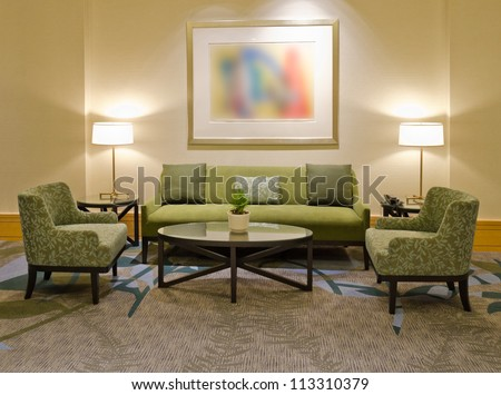 Lounge area of a hotel. Fragment of the lobby of the five stars hotel. Interior design. - stock photo