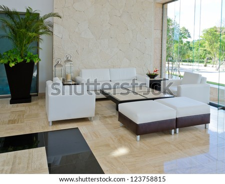 Lounge area of a hotel. Fragment of the modern lobby of the five stars hotel in Mexico. Interior design. - stock photo