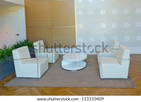 Lounge area of a hotel. Fragment of the modern lobby of the five stars hotel. Interior design. - stock photo