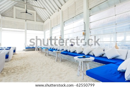 lounge bar on the beach, wooden house interior decorated with white and blue color - stock photo