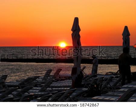 lounge beach at sunset in the hotel Jemchujina, Sochi, Russia - stock photo