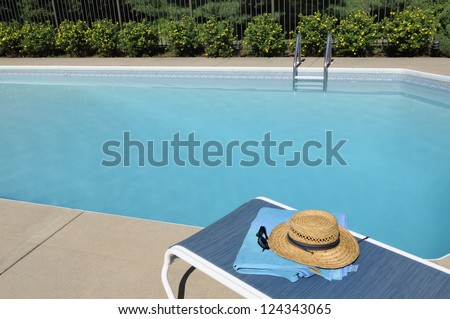Lounge Chair by Swimming Pool - stock photo