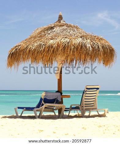Lounge chair on caribbean sea - stock photo