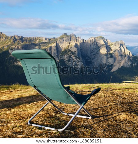 lounge chair with mountain view
