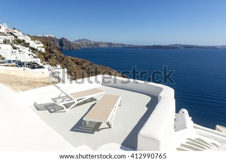Lounge chairs and sea in Santorini, Greece - stock photo