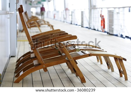 Lounge chairs on a cruise ship - stock photo