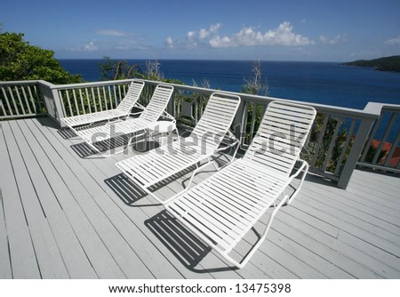 lounge chairs on deck overlooking ocean