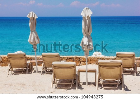 Lounge chairs on the beach in Sani, Greece